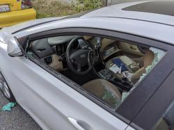 This Thursday, May 21, 2020, photo shows a parked car with a broken driver's side window after a smash-and-grab break-in in Los Angeles.