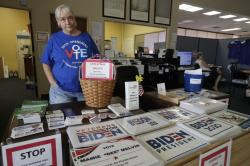 Chris Stanley, leader of The Villages Democrats Club, shows off some of the signs available at the Democratic Headquarters Monday, June 29, 2020, in Wildwood, Fla.