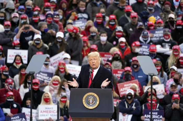 President Donald Trump speaks during a campaign rally at Mahester-Boston Regional Airport.