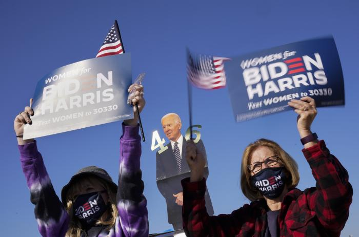 Supporters listen as Democratic presidential candidate former Vice President Joe Biden speaks at a rally at the Iowa State Fairgrounds in Des Moines, Iowa.