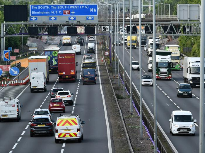 In this May 18, 2020, file photo, traffic moves along the M6 motorway near Birmingham, England