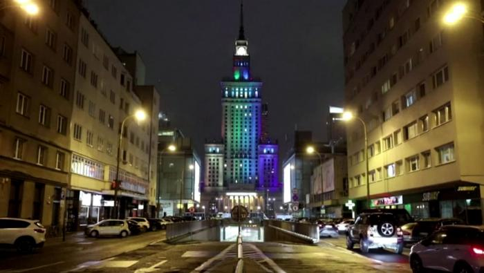 A building in Warsaw is lit in rainbow colors on Monday, November 16, 2020