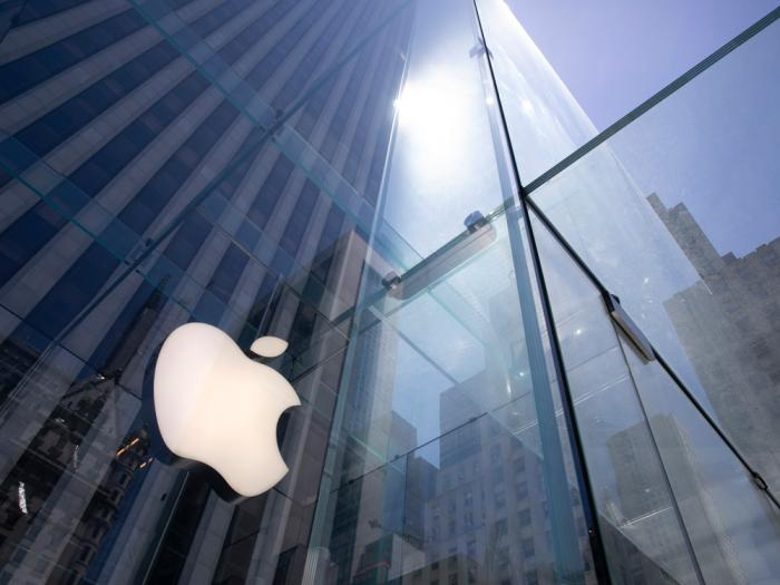 In this Tuesday, June 16, 2020 file photo, the sun is reflected on Apple's Fifth Avenue store in New York