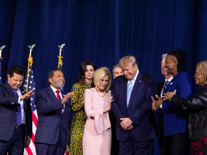 "In this Jan. 3, 2020 file photo, faith leaders pray over President Donald Trump during an ""Evangelicals for Trump Coalition Launch"" at King Jesus International Ministry in Miami"