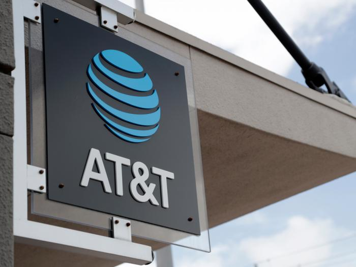 In this July 18, 2019, file photo, a sign is displayed at an AT&T retail store in Miami