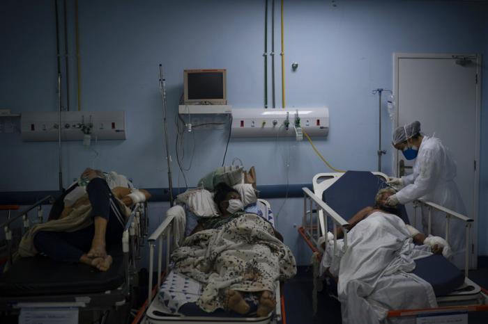 Patients waiting for test results are treated in a temporary room before being moved to a COVID-19 area of the municipal hospital in Sao Joao de Meriti, Rio de Janeiro state, Brazil.