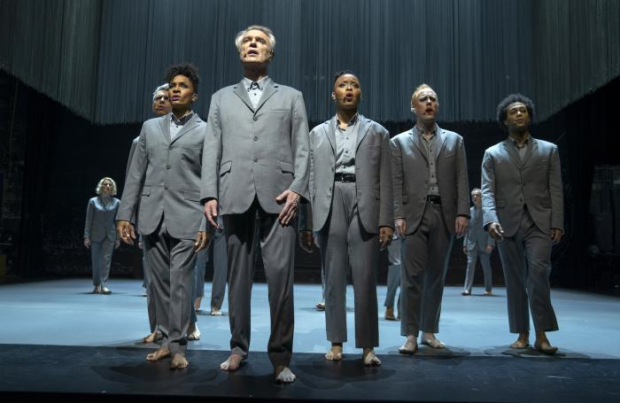 """David Byrne, foreground, in a scene from """"David Byrne's American Utopia."""""""